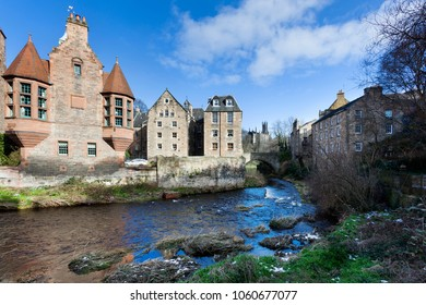 Historic houses along Leith river in Dean village in Edinburg with Rhema Christian Centre Church in the background