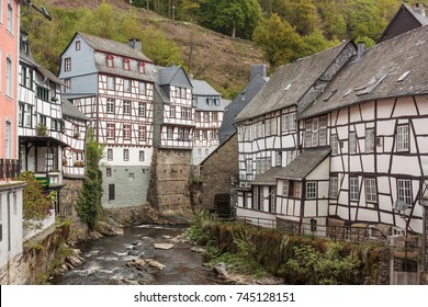 Historic houses along the river Rur in Monschau in the Eifel mountains, Germany. Half-timbered with slate roofs.
