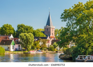 Historic houses alongside the Dutch river Vecht in the village of Vreeland