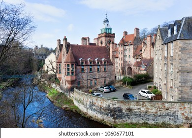 Historic houses and church along Leith river in Dean village in Edinburg