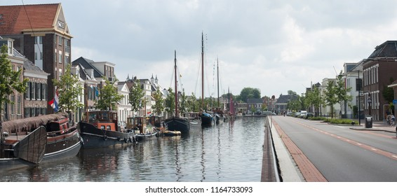 Historic houses and historic ships along the canal in the city of Assen, Drenthe, Netherlands