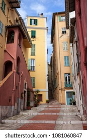 Historic houses and stepped alley in Old Town of Menton on French Riviera in France, Europe