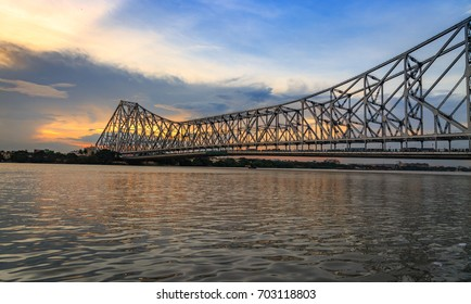 Historic Howrah bridge - A cantilever bridge on river Hooghly with moody sunset sky