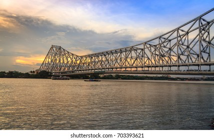Historic Howrah bridge - The cantilever bridge on river Hooghly at sunset with moody sky.