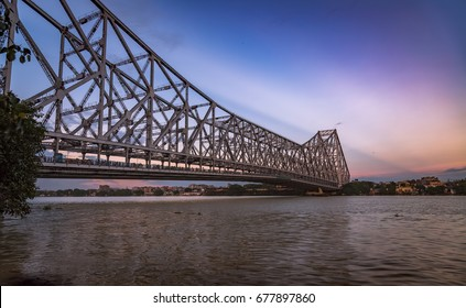 Historic Howrah bridge on river Hooghly at twilight. Howrah bridge is a cantilever bridge and the busiest in India.