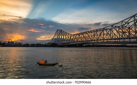 Historic Howrah bridge on river Hooghly with moody sunset sky