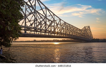 Historic Howrah bridge at sunrise with moody sky. Howrah bridge is a cantilever bridge on river Hooghly at Kolkata, India.