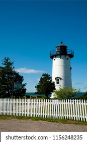 Historic island lighthouse, East Chop light, sits atop Telegraph Hill overlooking the ocean on Martha's Vineyard island on a summer sunny day in Massachusetts.