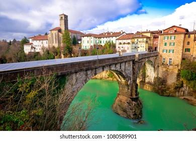 Historic italian landmarks in Cividale del Friuli, Devil's Bridge over green Natisone river, Friuli-Venezia Giulia region of Italy