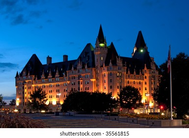Historic landmark, the Chateau Laurier Hotel in Ottawa, lit up at dusk