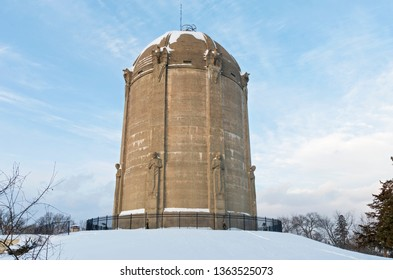 historic landmark water tower listed on national historic register atop snow covered  hill in tangletown neighborhood of minneapolis minnesota