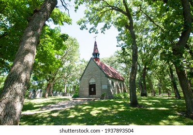 The historic little granite Chapel of the Assumption of Mary, also called the Grasshopper Chapel, in Cold Spring, Minnesota