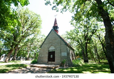 Historic little granite Chapel of the Assumption of Mary, also called Grasshopper Chapel, in Cold Spring, Minnesota