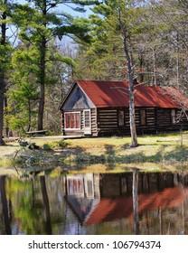 Historic Log Cabin reflecting in a pond, Sleeping Bear Dunes ,Michigan USA