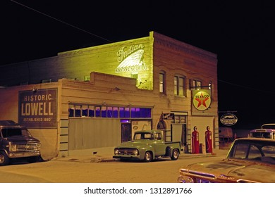 Historic Lowell, Arizona/USA - February 8, 2019: Night shot of an historic gas station on main street