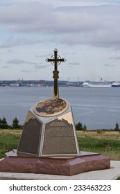 Historic marker with cross honors the Grand Derangement, the deportation of Acadians in the 18th century, Fort Amherst National Historic Site, Prince Edward Island, Canada