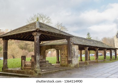 The historic market hall in Bingley, including the stocks for dodgy tradesmen