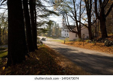 The Historic Marlboro Meeting House Congregational Church is framed by shady trees on a country road in Marlboro, Windham County, Vermont, USA