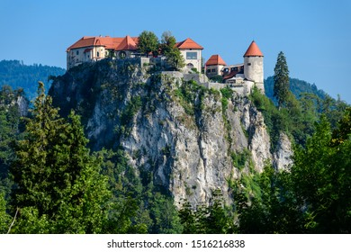 The historic medieval castle on a rock on the shore of Lake Bled is a symbol of Slovenia. Shot from Mount Straza Bled. Europe.