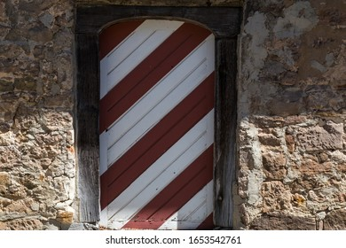 historic medieval door in red and white