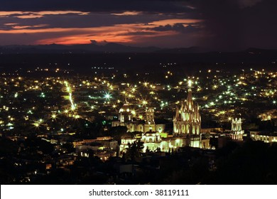 The historic Mexican city of San Miguel de Allende with the La Parroquia (Church of St. Michhael the Archangel) in foreground.