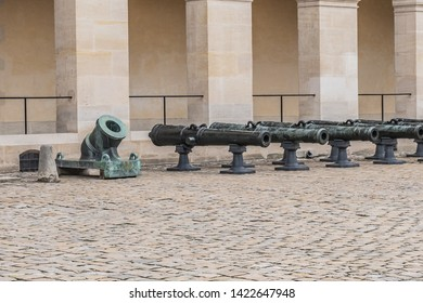 Historic Napoleonic artillery gun near Les Invalides in Paris. Les Invalides (National Residence of Invalids) - complex of museums and monuments relating to military history of France. Paris, France.