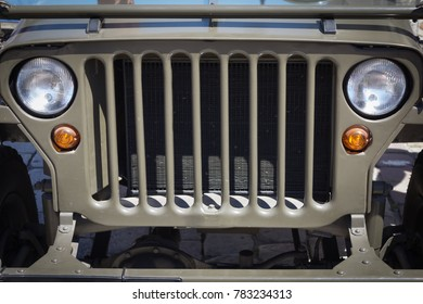 Historic off-road vehicle, view of the grill and front lights
