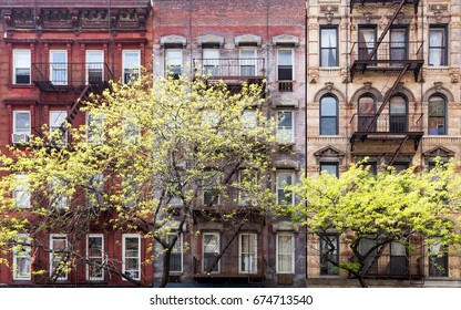 Historic old buildings and trees along 3rd Avenue in the East Village of Manhattan, New York City NYC