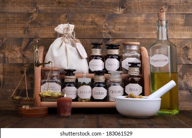 Historic old pharmacy bottles with label and Old-fashioned weight scales, on wooden background