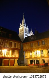 The historic old town inside the walls of Vannes city, during the night in summer. Place Henri-IV. View of the cathedral entrance. Brittany, France