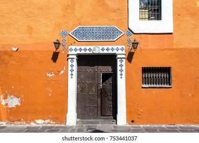 Historic orange colonial building in the center of Puebla, Mexico