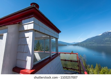 The historic Pilot Bay Lighthouse over looking Kootenay lake in British Columbia, Canada.  It used to guide old sternwheeler ships along its shores and now sits in the Pilot Bay Provincial Marine Park