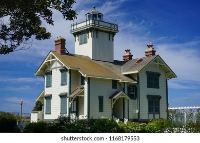 Historic Point Fermin Lighthouse, view of rear and south sides of the Victorian architecture, built 1874. A southern California landmark under a brilliant sky
