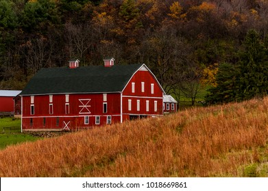 A historic red and white barn on a scenic farm in the Appalachian Mountains in Somerset County, Pennsylvania.