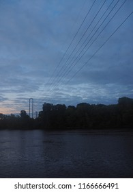 Historic River in Minneapolis with Bridge, Train and Power lines