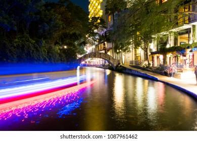Historic River Walk area at night downtown in San Antonio Texas.