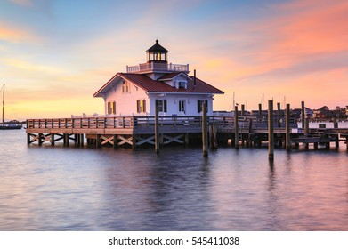 The historic Roanoke Marshes Lighthouse at sunrise on Shallowbag Bay on the Roanoke Sound in Manteo, North Carolina, Outer Banks.