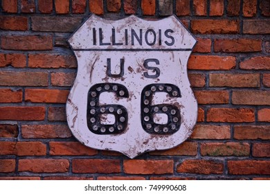 Historic Route 66 road sign painted on a brick wall in Illinois