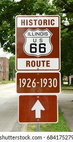 "Historic Route 66 sign in Illinois showing the route that was used during the years 1926-1930 which was the first route that was created for the historic ""Mother Road."""