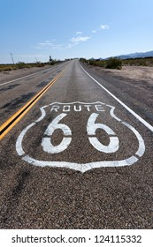 Historic Route 66 sign on asphalt, California. - Shutterstock ID 124115332