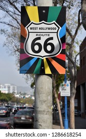The historic Route 66 sign on Santa Monica Blvd in West Hollywood has been decorated with the gay pride rainbow
