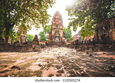 Historic ruins of ancient capital city of Thailand with temples in magic golden light. Ayutthaya, Thailand