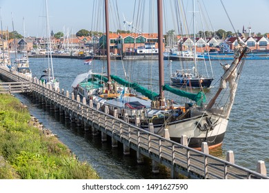 Historic sailing ship moored at pier of Dutch fishing village Urk