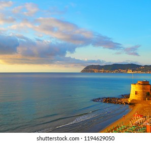 Historic Saracen tower on the beach in the Mediterranean city of Alassio on  the Sunset, a popular resort town on the Italian Riviera, provincia Savona, Liguria, Italy