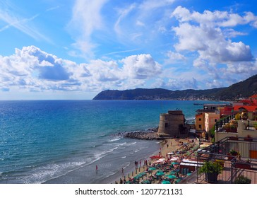 Historic Saracen tower on the beach in the Mediterranean city of Alassio on popular resort town on the Italian Riviera, provincia Savona, Liguria, Italy