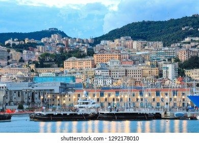 The historic seaport of Genoa (Genova), Italy is a popular cruise port and a favorite travel and tourism destination.  The cityscape skyline is full of boats and yachts and colorful buildings.