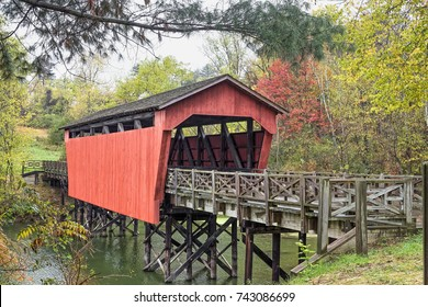 The historic Shaeffer Campbell Covered Bridge crosses College Pond on a campus in St. Clairsville, Ohio.