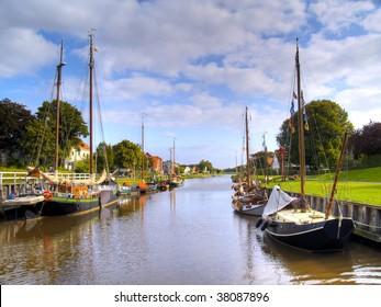 historic ships in the old harbor of carolinensiel, germany
