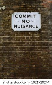 Historic sign in Southwark, London warning passers-by to 'commit no nuisance'.