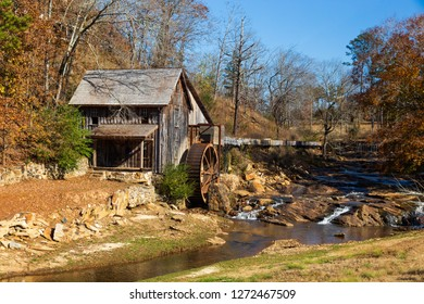 Historic Sixes Mill from the 1800s in Canton, Georgia, during autumn.